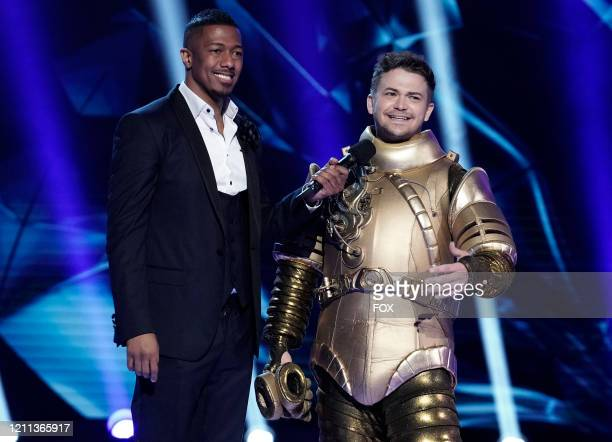 Host Nick Cannon and Hunter Hayes in the The Battle of The Sixes The Final 6 episode of THE MASKED SINGER airing Wednesday April 29 on FOX