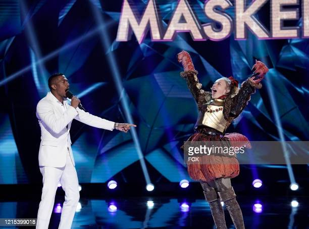 Host Nick Cannon and Jo Jo Siwa in the Old Friends, New Clues: Group C Championships episode of THE MASKED SINGER airing Wednesday, March 25 on FOX.