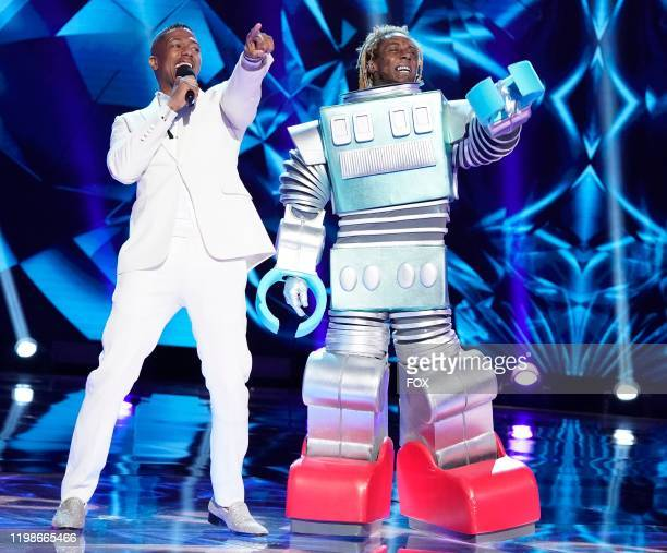 Host Nick Cannon and Lil Wayne in the Season Three premiere of THE MASKED SINGER airing Sunday Feb 2 on FOX following SUPER BOWL LIV THE MASKED...