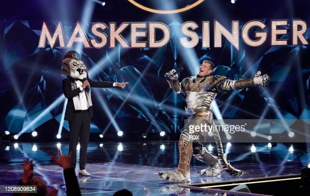 : Host Nick Cannon and Rob Gronkowski in The Super Nine Masked Singer Special: Groups A, B & C special two-hour episode of THE MASKED SINGER airing...
