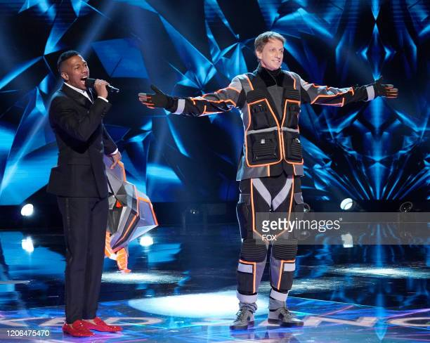 Host Nick Cannon and Tony Hawk in the A Brand New Six Pack Group B Kickoff episode of THE MASKED SINGER airing Wednesday Feb 19 on FOX
