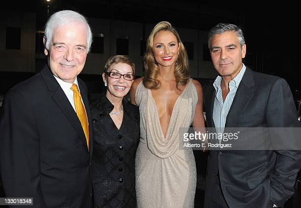 TV host Nick Clooney Nina Bruce actress Stacy Keibler and actor George Clooney arrive to the premiere of Fox Searchlight's The Descendants at AMPAS...