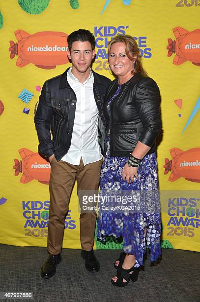 Host Nick Jonas and President of Nickelodeon and Viacom Media Networks Kids Family Group Cyma Zarghami attend Nickelodeon's 28th Annual Kids' Choice...
