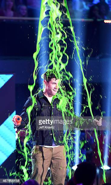 Host Nick Jonas gets slimed onstage during Nickelodeon's 28th Annual Kids' Choice Awards held at The Forum on March 28 2015 in Inglewood California