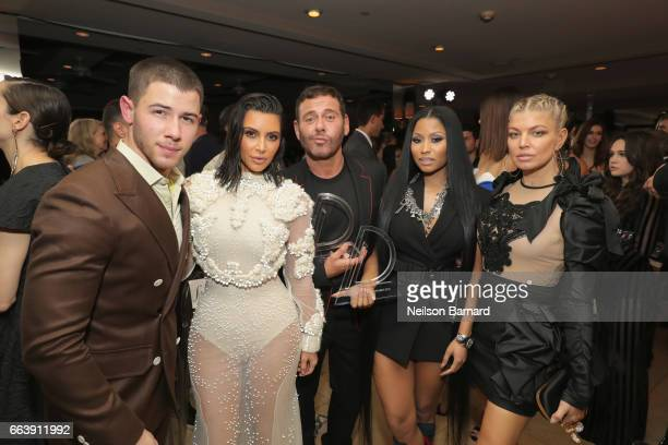Host Nick Jonas Kim Kardashian West Mert Alas with his award for Creative of the Year Nicki Minaj with her award for Fashion Rebel and Fergie attend...