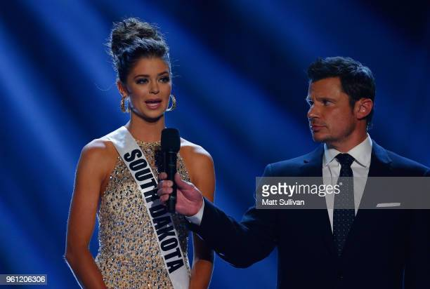 Host Nick Lachey talks with Miss South Dakota Madison Nipe during the 2018 Miss USA Competition at George's Pond at Hirsch Coliseum on May 21 2018 in...