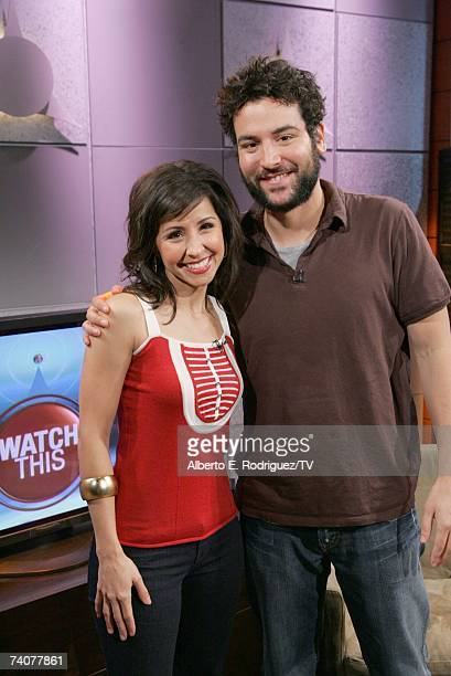 Host Nikki Boyer and actor Josh Radnor pose on the set of Watch This at the Television Guide Channel Studios on April 27 2007 in Hollywood California
