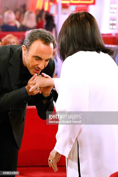TV host Nikos Aliagas and Main Guest of the show singer Nana Mouskouri attend the 'Vivement Dimanche' French TV Show at Pavillon Gabriel on November...