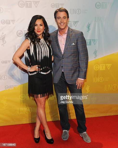 Host of ETalk Tanya Kim and Ben Mulroney on the Red Carpet at the 2013 Juno Awards held at the Brandt Centre on April 21 2013 in Regina Canada