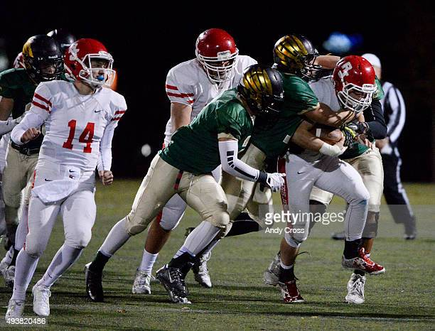 A host of Mountain Vista defenders swarm Regis Jesuit RB Alec Barnes in the first quarter at Shea Stadium October 22 2015 Photo by Andy Cross/The...