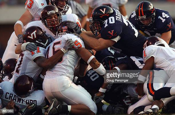 Host of players including cornerback Garnell Wilds and linebacker Mikal Baaque of the Virginia Tech Hokies and linebacker Antonio Mayfield and center...