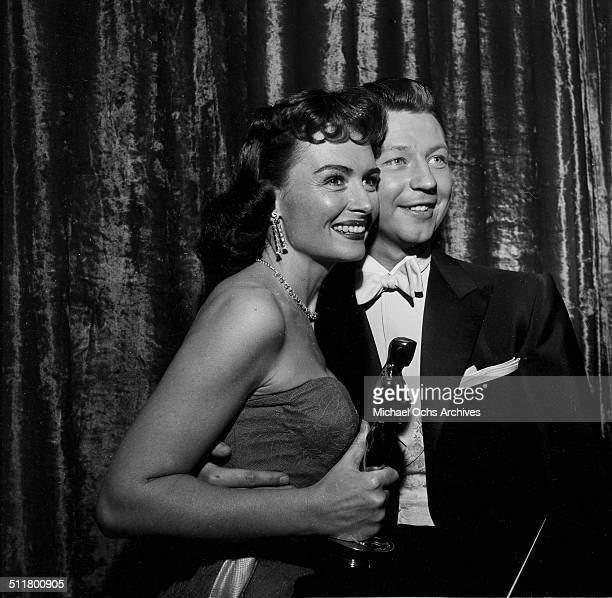 Host of the Academy Awards Donald O'Connor poses with winner Donna Reed for Actress in a Supporting Role in Los Angeles,CA.\