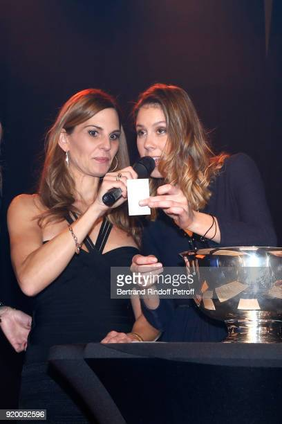 Host of the evening Journalist at RTS Katia Hess and Fanny Leeb perform during the Snow Night La Nuit des Neiges Charity Gala on February 17 2018 in...