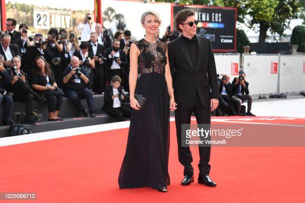 Host of the festival Michele Riondino and Eva Nestori walk the red carpet ahead of the opening ceremony and the 'First Man' screening during the 75th...