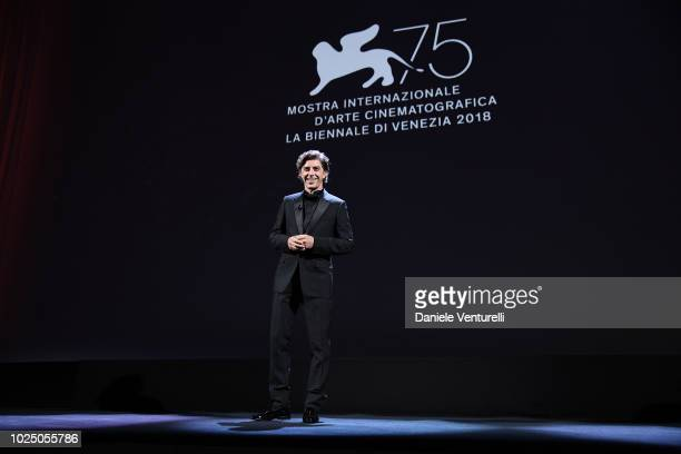 Host of the festival Michele Riondino speaks during the opening ceremony and the 'First Man' screening during the 75th Venice Film Festival at Sala...