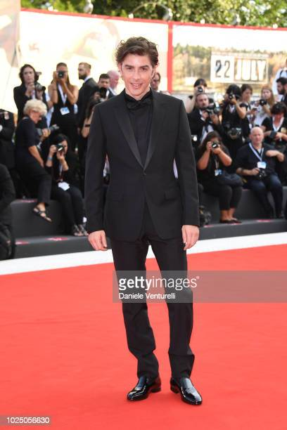 Host of the festival Michele Riondino walks the red carpet ahead of the opening ceremony and the 'First Man' screening during the 75th Venice Film...
