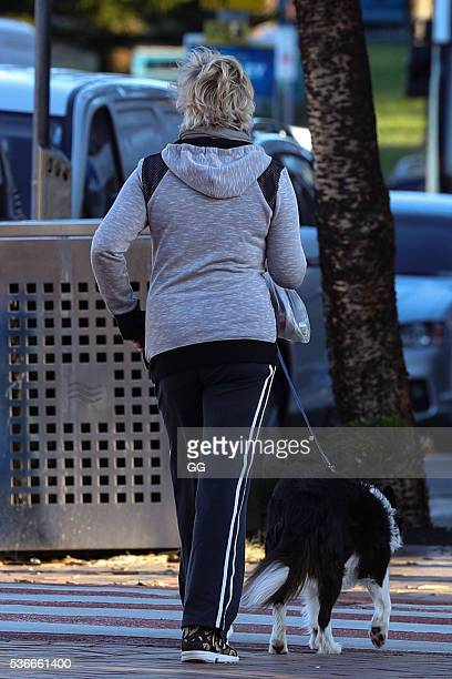 Host of 'The Living Room' Amanda Keller enjoys an evening stroll at Bondi with her dog and son on May 27 2016 in Sydney Australia