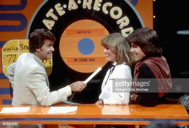 Host of the television series 'American Bandstand' Dick Clark asks members of the studio audience their opinions on a new release in 1980 in Los...