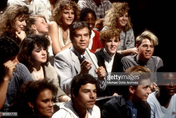 Host of the television series 'American Bandstand' Dick Clark sits with the studio audience in 1980 in Los Angeles, California.