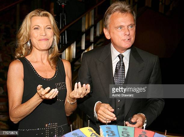 Host of the TV game show 'Wheel Of Fortune' Pat Sajak and model Vanna White feed each other cake at the the 25th anniversary celebration of 'Wheel Of...