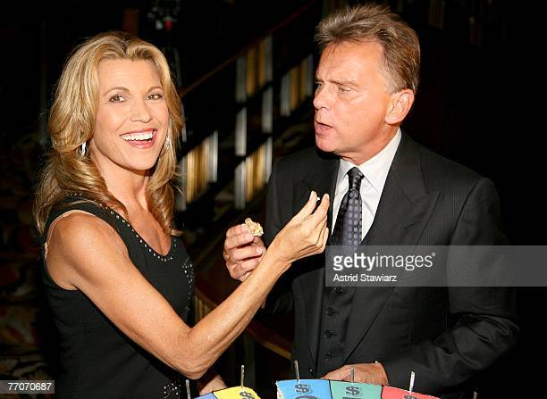 Host of the TV game show Wheel Of Fortune Pat Sajak and model Vanna White feed each other cake at the the 25th anniversary celebration of Wheel Of...
