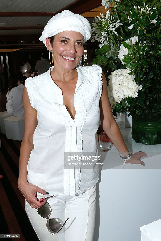 Host of the TV show 'New Look for a New Life' on M6 Cristina Cordula attends 'Brunch Blanc' hosted by Groupe Barriere for Sodexho with a cruise in Paris on June 30, 2013, France.