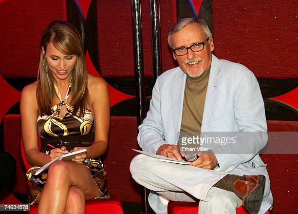 Host of Vegas Minute Danielle Demski with actor and chair of the CineVegas creative advisory board Dennis Hopper judge the five Vegascom commercial...