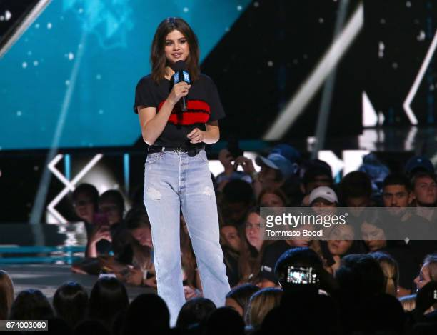 Host of WE Day California actress/singer and UNICEF Goodwill Ambassador Selena Gomez speaks onstage at WE Day California to celebrate young people...