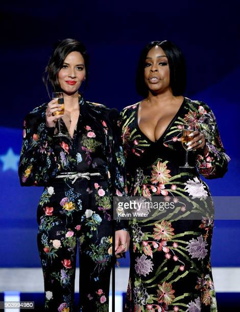 Host Olivia Munn and actor Niecy Nash speak onstage during The 23rd Annual Critics' Choice Awards at Barker Hangar on January 11 2018 in Santa Monica...