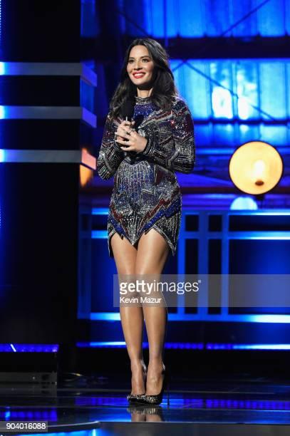 Host Olivia Munn speaks onstage at The 23rd Annual Critics' Choice Awards at Barker Hangar on January 11 2018 in Santa Monica California