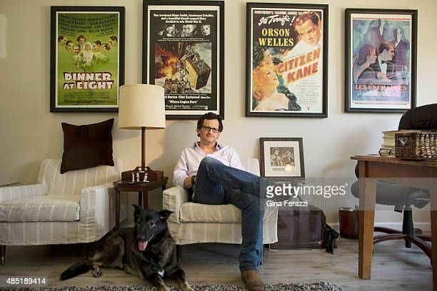 Host on TCM Ben Mankiewicz is photographed with his favorite dob Bob in his home office for Los Angeles Times on July 15 2015 in Santa Monica...