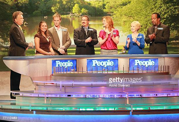 Host Pat Sajak greets Megan Sippey actor Neil Patrick Harris Seth Ramus actress Diane Neal Diana Mallon and actor Robert Gossett during a taping of...