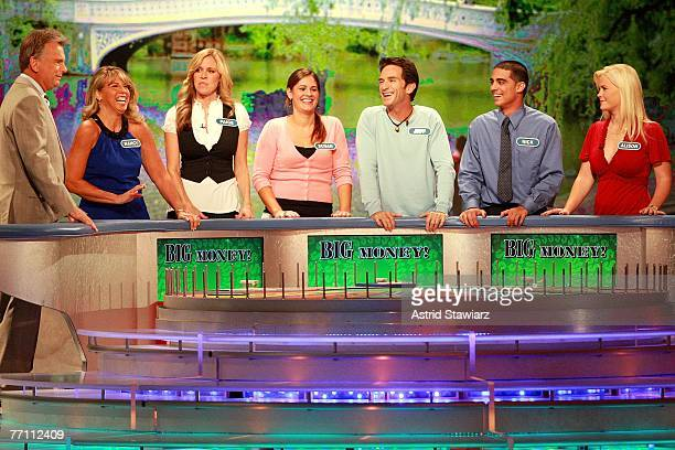 Host Pat Sajak greets Nancy Kaufman actress Paige Hemmis Susan Moran actor Jeff Probst Nick Giovine and actress Alison Sweeney during a taping of...