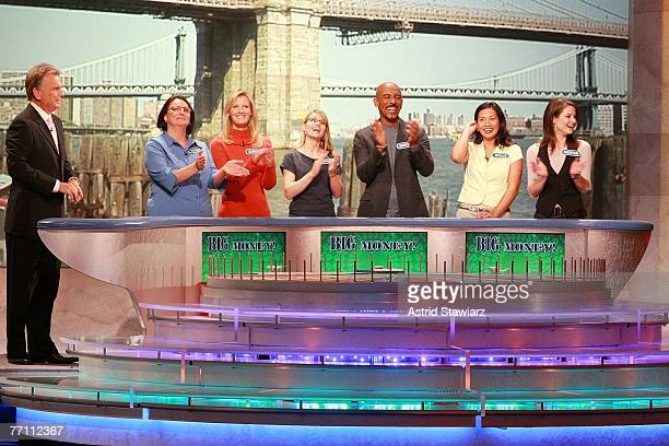 Host Pat Sajak greets Theresa Feeney actress Sandra Lee April Baker actor Montel Williams Dolly DeSantis and actress Kristan Cunningham guess at a...