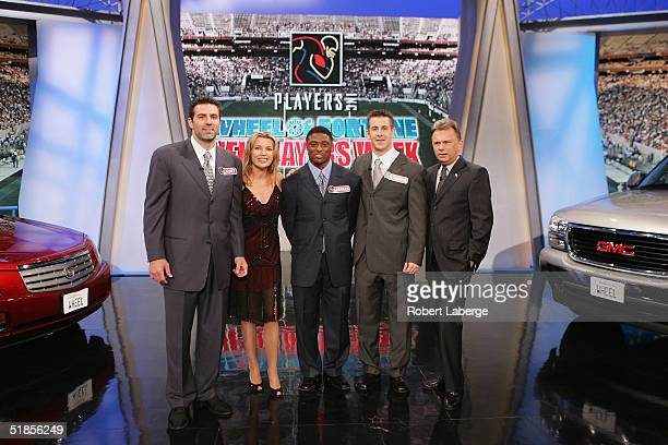 Host Pat Sajak stands with Brandon Stokley of the Indianapolis Colts Warrick Dunn of the Atlanta Falcons CoHost Vanna White and Kurt Warner of the...