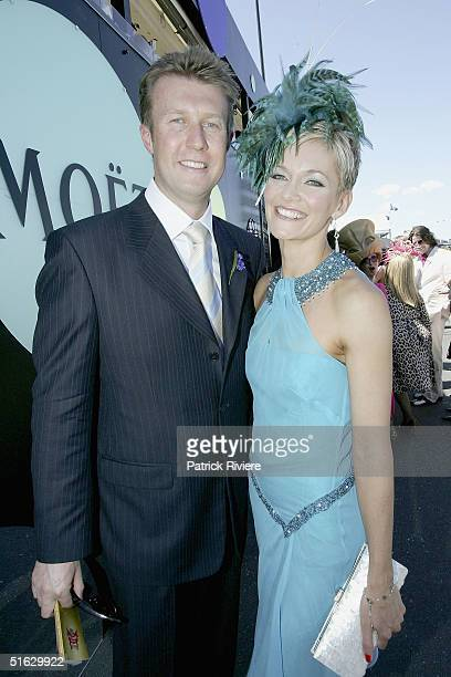 TV host Peter Overton and his wife newsreader Jessica Rowe attend the Melbourne Cup Carnival's Derby Day in the Moet et Chandon marquee at Flemington...