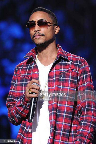 Host Pharell Williams speaks at the BET SOS Saving Ourselves Help for Haiti benefit concert and telethon at AmericanAirlines Arena on February 5 2010...