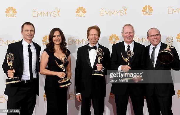 Host Phil Keoghan Executive Producers Elise Doganieri Jerry Bruckheimer Bertram van Munster and Jonathan Littman winners of the Outstanding Reality...