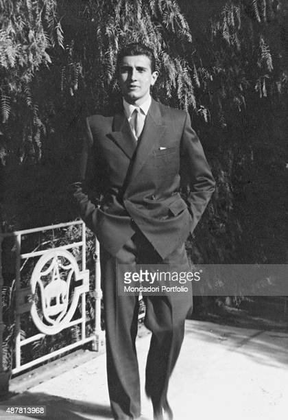 TV host Pippo Baudo posing with his hands in his pockets for a photo shoot in a garden Italy early '60s