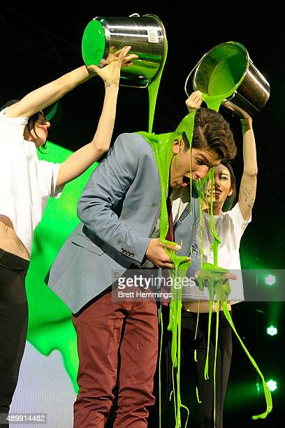 Host Rahart Adams is slimed by The Veronicas during the Nickelodeon Slimefest 2015 matinee show at Sydney Olympic Park Sports Centre on September 25...
