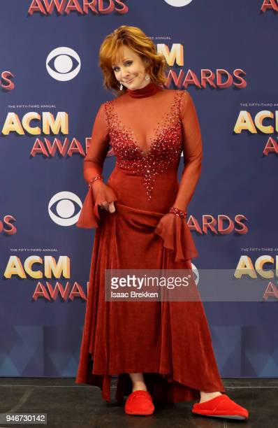 Host Reba McEntire fashion and shoe details poses in the press room during the 53rd Academy of Country Music Awards at MGM Grand Garden Arena on...