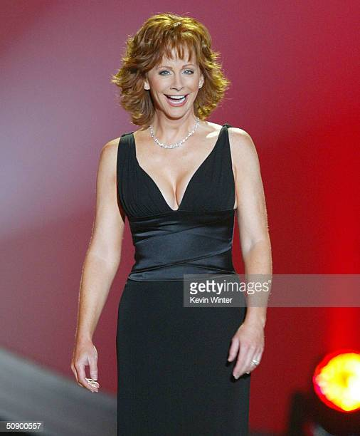 Host Reba McEntire presents on stage at the '39th Annual Country Music Awards' at the Mandalay Bay Hotel Casino on May 26 2004 in Las Vegas Nevada