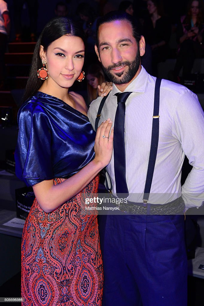 TV host Rebecca Mir and Massimo Sinato attend the 'The Power Of Colors - MAYBELLINE New York Make-Up Runway' show during the Mercedes-Benz Fashion Week Berlin Autumn/Winter 2016 at Brandenburg Gate on January 18, 2016 in Berlin, Germany.