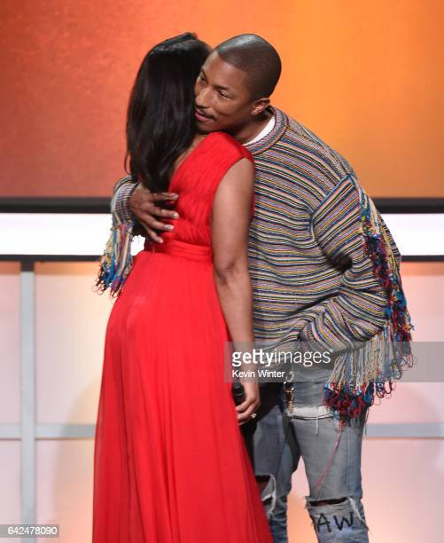 Host Regina Hall and recording artist Pharrell Williams speak onstage during BET Presents the American Black Film Festival Honors on February 17 2017...