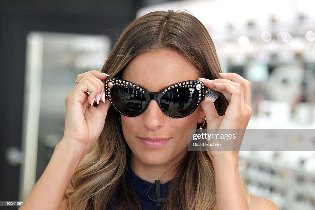 EXTRA host Renee Bargh shows off the latest Spring/Summer Sunglass trends at Westfield Century City on May 13, 2014 in Los Angeles, California.
