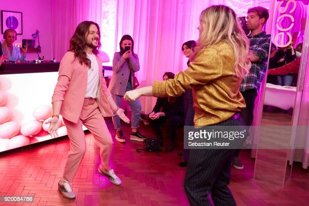 Host Riccardo Simonetti and musician Jack Strify dance at Celebrating Women In Film hosted by Riccardo Simonetti for eos evolution of smooth at Soho...