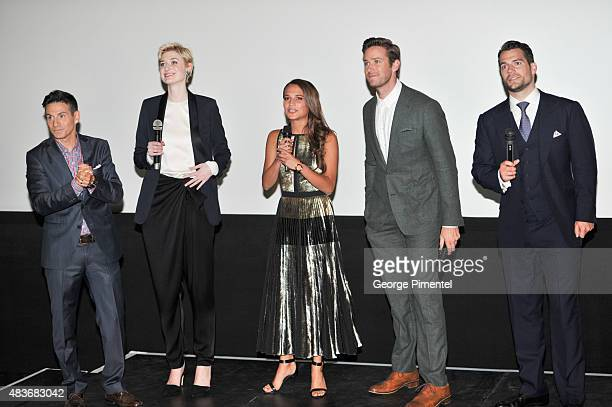 ET Host Rick Campanelli with Cast members Elizabeth Debicki Alicia Vikander Armie Hammer and Henry Cavill attend the premiere of Warner Bros...