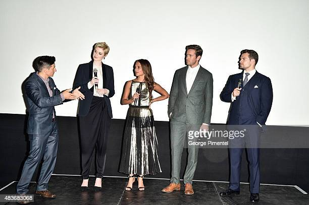 Host Rick Campanelli with Cast members Elizabeth Debicki Alicia Vikander Armie Hammer and Henry Cavill attend the premiere of Warner Bros Pictures'...