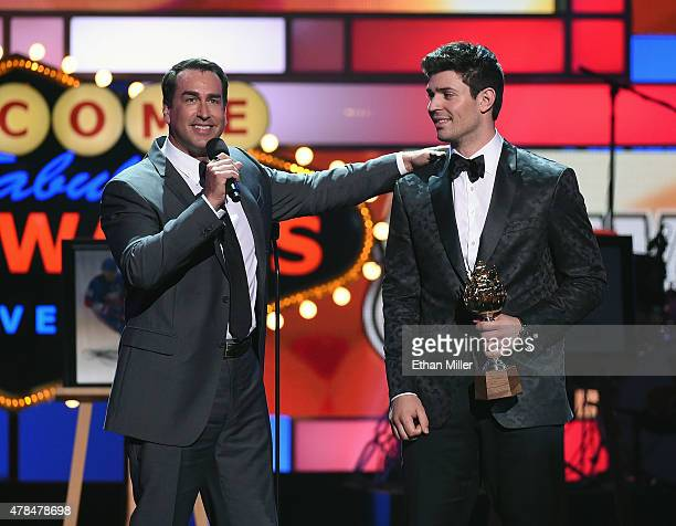 Host Rob Riggle presents the Hart Memorial Trophy to Carey Price of the Montreal Canadiens during the 2015 NHL Awards at MGM Grand Garden Arena on...