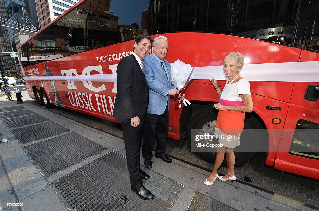 TCM host Robert Osborne (C) is joined by actress Jane Powell (R) and Dennis Adamovich (L), Senior Vice President of digital, affiliate, lifestyle and enterprise commerce, TCM, TBS and TNT to launch the 'TCM Classic Film Tour' on August 20, 2013 in New York City. Featuring stops at some of the most famous movie locations throughout the city, this sightseeing bus tour opens to the public Thursday, Aug. 22, running Tuesdays, Thursdays and Saturdays, beginning at 11:30 a.m. The three-hour sightseeing bus tour will take movie fans to some of the city's greatest filming locations, including the Empire State Building (King Kong); Zabar's market (Manhattan, You've Got Mail); Holly Golightly's brownstone (Breakfast at Tiffany's); the famed subway grate that blew Marilyn Monroe's skirt (The Seven-Year Itch); Grand Central Terminal (North by Northwest, Superman); and, of course, Central Park. (Photo by Mike Coppola/WireImage) 23987_004_MC_ 0044.JPG Robert Osborne; Jane Powell; Dennis Adamovich